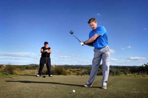 Golf with Damien Thomlinson0